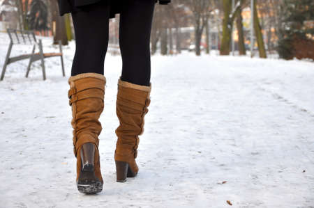 knee boots: close up of brown leather knee boots Stock Photo