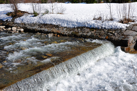 river and thawing snow from the mountains Stock Photo