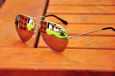 ray ban: Sun glasses on the brown wood table Stock Photo
