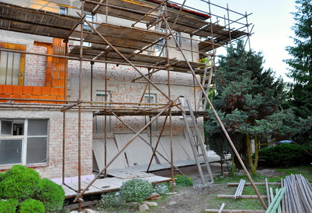 Scaffolding on the house, reconstruction, new windows