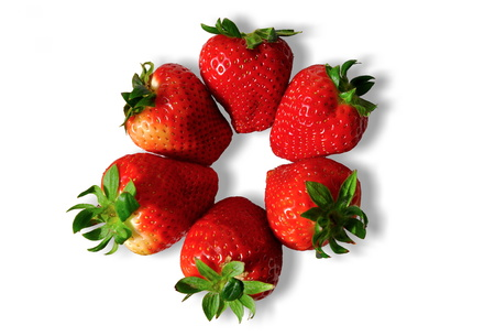 isolated plate of red sweet beautiful strawberries