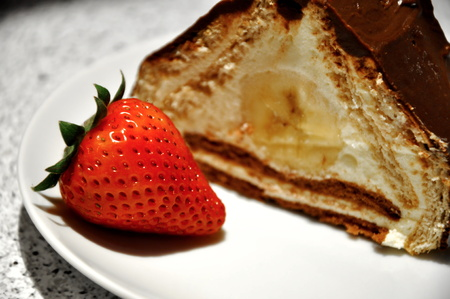 detail of chocolate cake with strawberry on plate