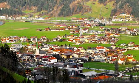 beautiful panorama of town in great valley alps photo