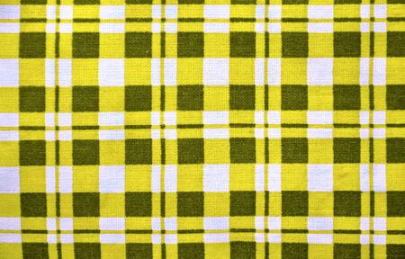 close up of yellow and white square fabric  photo