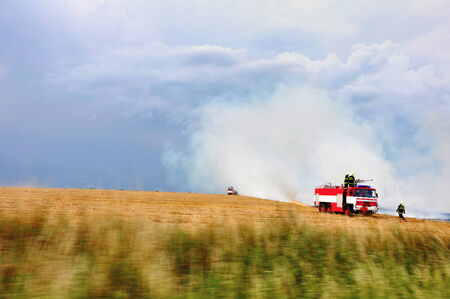 act of god: firefighters in burning field