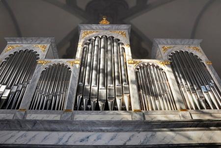 pipe organ: big pipe organ in church Editorial