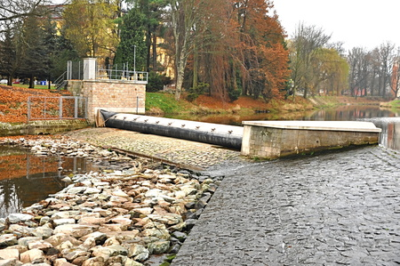 weir: river with weir in town