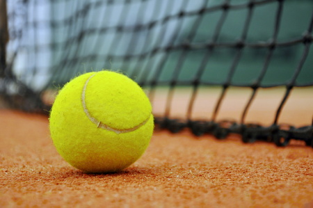 close up of tennis ball in tennis court photo