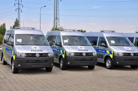 vw: PRAGUE, THE CZECH REPUBLIC, 02.08.2015 - Brand new police cars VW Multivan parking in front of Car Store Volkwagen in Prague