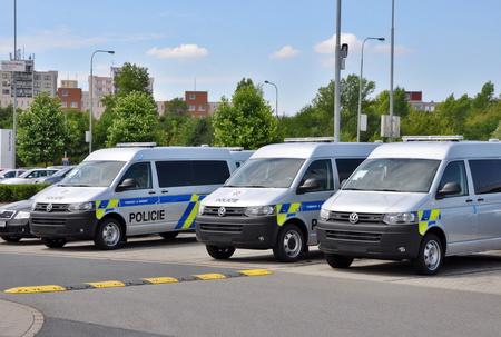 t5: PRAGUE, THE CZECH REPUBLIC, 02.08.2015 - Brand new police cars VW Multivan parking in front of Car Store Volkwagen in Prague