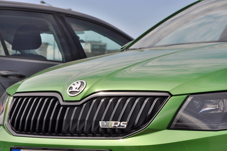 PRAGUE, THE CZECH REPUBLIC, 02.08.2015 - green Skoda Octavia RS in front of car store Skoda auto in Prague Publikacyjne
