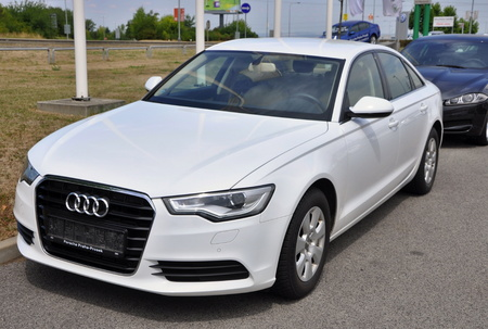 a6: PRAGUE, THE CZECH REPUBLIC, 02.08.2015 - Brand new white Audi A6 parks in front of Car Store Audi