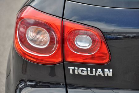 t5: PRAGUE, THE CZECH REPUBLIC, 02.08.2015 - detail of Volkswagen Tiguan car parks in front of VW car store Editorial