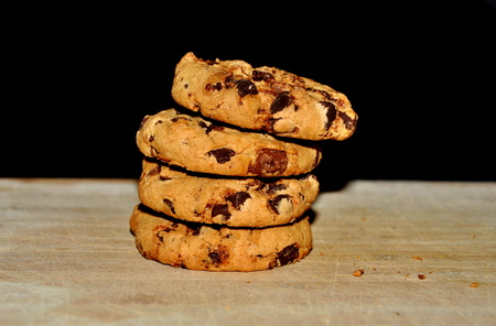 Chocolate cookies on wood background, close up