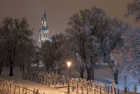 lesser: Upper castle in Prague in snowy night in winter