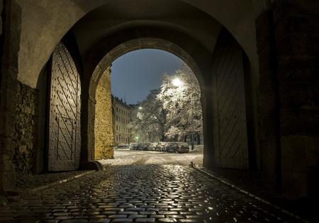 big scenery: Night view through big gate to winter scenery in Prague city