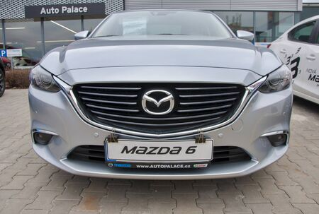 mazda: PRAGUE, THE CZECH REPUBLIC, 12.03.2016 - Mazda car in front of car store Mazda in Prague