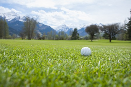 Close up of golf ball in golf course in Alps Stock Photo