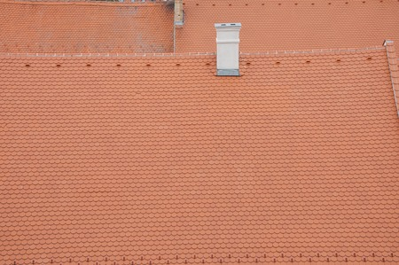 ridge: Closeuf of new roof orange shingles with ridge tiles Stock Photo