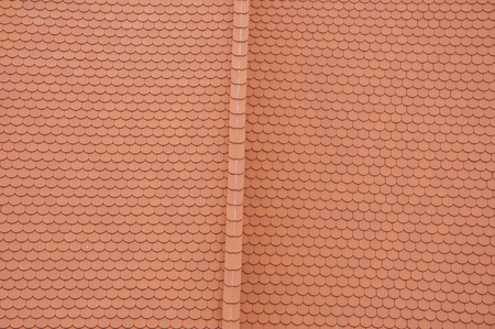roof ridge: Closeuf of new roof orange shingles with ridge tiles Stock Photo
