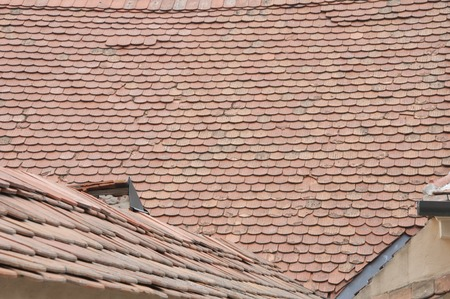 shingles: Closeup of new and old roof orange shingles with ridge tiles Stock Photo