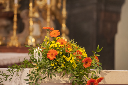 christian marriage: Beautiful blossom arrangement with cross in church
