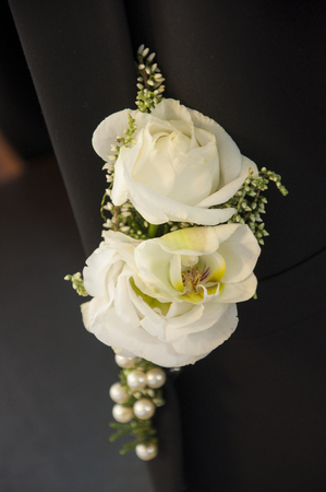 Close up of grooms flower on his suit Stock Photo