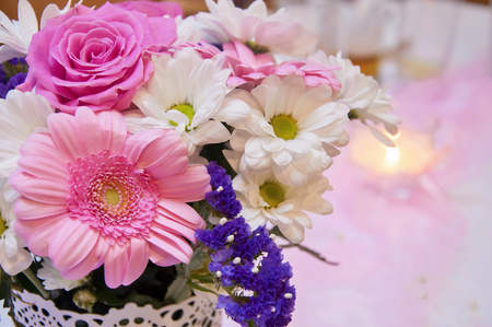 formal dinner party: Beautiful wedding arrangement- Wedding decoration in pink color. Beautiful flowers, decor and candle on wedding party. Christian wedding Stock Photo