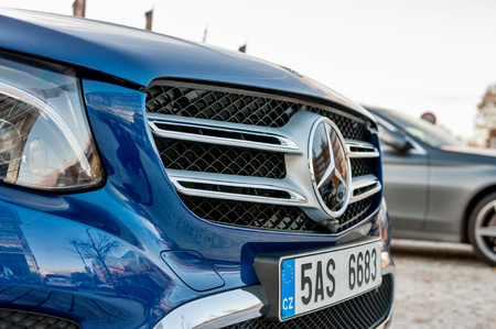 daimler: PRAGUE, THE CZECH REP., NOVEMBER 27, 2016: Closeup of front mask with logo of luxury car Mercedes-Benz GLC 220d parking in front of car store Daimler. Editorial