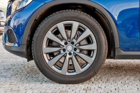 daimler: PRAGUE, THE CZECH REP., NOVEMBER 27, 2016: Closeup of car wheel of luxury car Mercedes-Benz GLC 220d parking in front of car store Daimler.