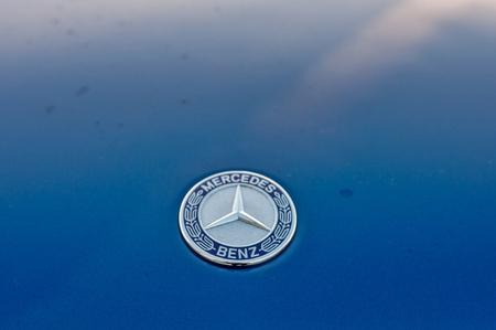 daimler: PRAGUE, THE CZECH REP., NOVEMBER 27, 2016: Closeup of logo luxury car Mercedes-Benz GLC 220d parking in front of car store Daimler. Editorial