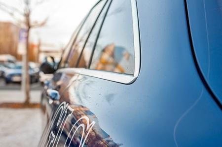 daimler: PRAGUE, THE CZECH REP., NOVEMBER 27, 2016: Closeup of rear light luxury car Mercedes-Benz GLC 220d parking in front of car store Daimler.