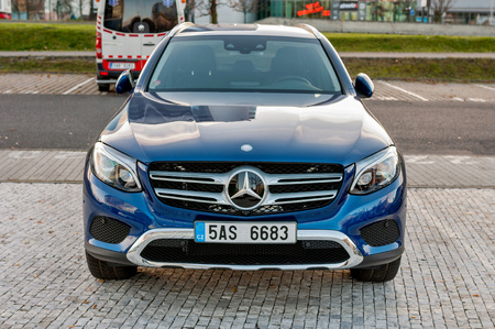 PRAGUE, THE CZECH REP., NOVEMBER 27, 2016: Closeup of front view luxury car Mercedes-Benz GLC 220d parking in front of car store Daimler.