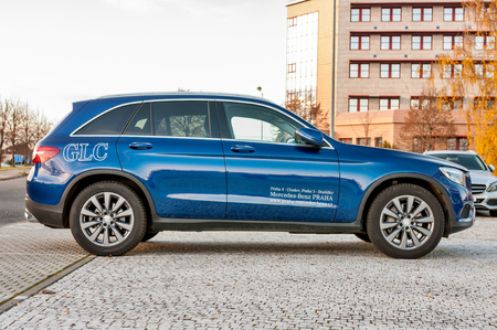 daimler: PRAGUE, THE CZECH REP., NOVEMBER 27, 2016: Profile view of luxury car Mercedes-Benz GLC 220d parking in front of car store Daimler.