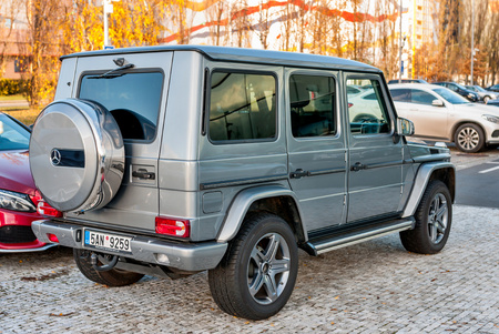 PRAGUE, THE CZECH REP., NOVEMBER 27, 2016: Closeup of new luxury car Mercedes-Benz G 350 d parking in front of car store. Detail of rear view of car Editorial