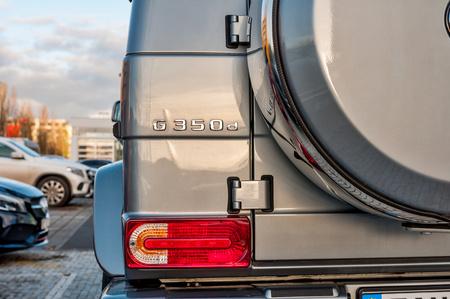 daimler: PRAGUE, THE CZECH REP., NOVEMBER 27, 2016: Closeup of new luxury car Mercedes-Benz G 350 d parking in front of car store. Detail of rear view of car Editorial