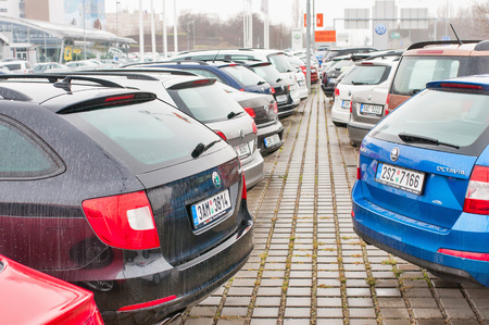 vw: PRAGUE, THE CZECH REPUBLIC, 18.12.2016 - Skoda and vw cars parked in row in front of official car dealer in Prague. Editorial