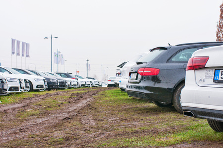 PRAGUE, THE CZECH REPUBLIC, 18.12.2016 - Audi cars parked in row in front of official car dealer Audi in Prague. Rear view of parked white and black cars in row. Editorial