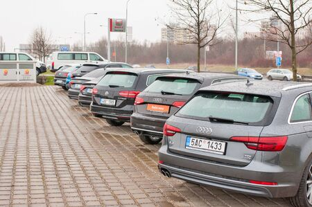 PRAGUE, THE CZECH REPUBLIC, 18.12.2016 - Luxury cars parked in front of car dealer.  view of parked luxury cars in row.