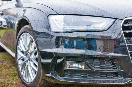 PRAGUE, THE CZECH REPUBLIC, 18.12.2016 - Front mask view of new black car Audi parked in front of Audi dealership. Editorial
