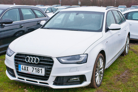 PRAGUE, THE CZECH REPUBLIC, 18.12.2016 - Front view of new white car Audi parked in front of Audi dealership. Closeup view of Audi