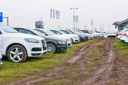 PRAGUE, THE CZECH REPUBLIC, 18.12.2016 - Audi cars parked in row in front of official car dealer Audi in Prague. Front view of white and black cars in row Editorial