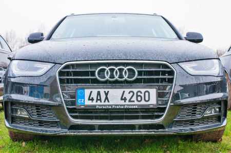 PRAGUE, THE CZECH REPUBLIC, 18.12.2016 - Front view of new car Audi parked in front of Audi dealership. Editorial