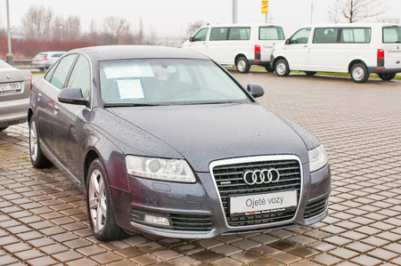 PRAGUE, THE CZECH REPUBLIC, 18.12.2016 - Closeup of new car Audi TDI quattro parking in front of car dealership Audi