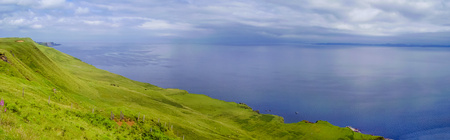 Beautiful panorama of Scotland coastline. Green Scotland Highlands and blu ocean. Skye Isle Stock Photo