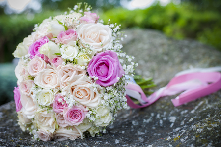 Closeup of beautiful wedding bouquet from roses. Bridal bouquet with white and pink roses. Wedding flowers
