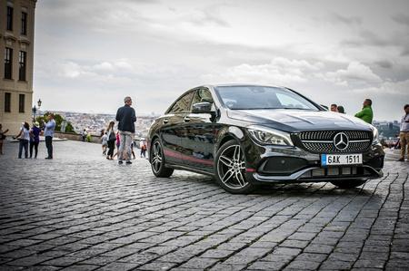PRAGUE,THE CZECH REPUBLIC, 31.8.2017: Mercedes Benz CLA 45 AMG, black car with red sports strips. Redakční