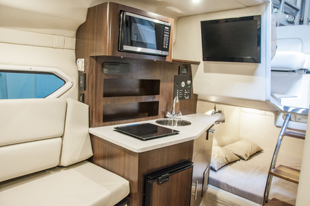 Interior of luxury yacht. Yacht cabin from leather material. Stock Photo