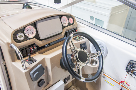 Closeup of cockpit of luxury yacht. Cockpit of luxury seagoing boat. interior from wood and leather. Stock Photo