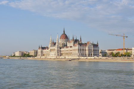 building a chain: Budapest in daylight from river. Parliament across the river Danube